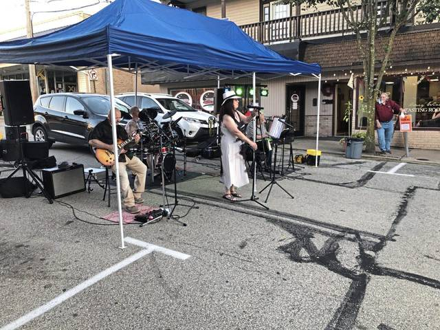 Gail Macioce, the singer in Gail, Kevin & Co., belts out a tune at Irwin's Music in the Streets on Thursday.