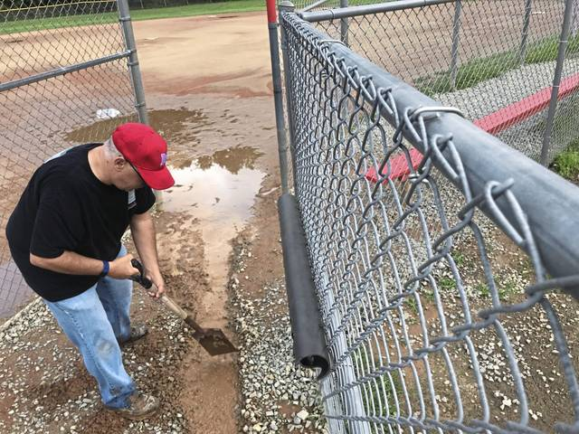 Rob Farroux digs out a trench to drain water from one of the ball fields during a volunteer cleanup event at the Police Athletic League of North Huntingdon complex on Saturday<ins>,</ins><ins> Aug. 29, </ins><ins>2020</ins>.