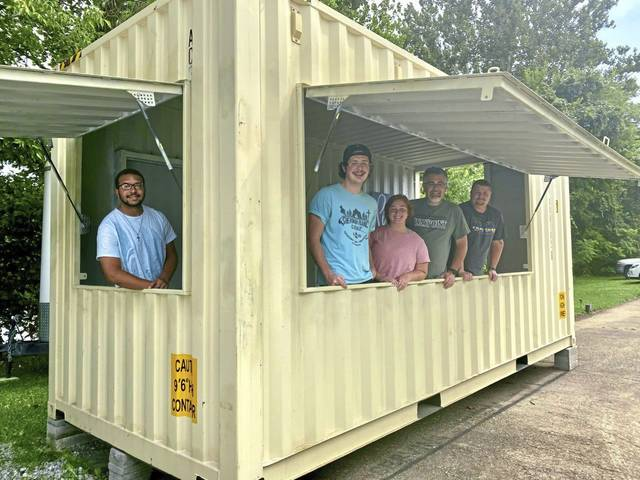 Staff with West Newton's Waypoint Youth and Community Center pose in August<ins> 2020</ins> inside a shipping container that is being re-purposed as a proposed food stand along Collinsburg Road, near the Great Allegheny Passage trail. From left are: Devon Koncz, boy coordinator; Declan Morse, executive coordinator; Azzia Berestecki, girl coordinator; Chris Morse, CEO; and Ronnie Coughanour, volunteer.