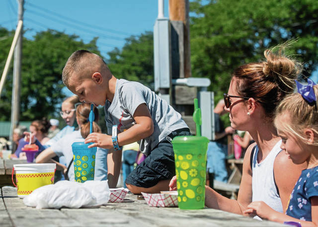 Jacob Culler, 4, of Latrobe enjoys a cold beverage at the marketplace.