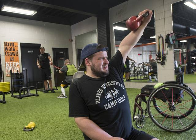 Nevin Gray, of Greensburg, works out inside of Piff's Power and Fitness in Youngwood on July 24, 2020.