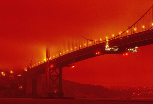 San Francisco's Golden Gate Bridge at 11 a.m. Wednesdayamid a smoky, orange hue caused by the ongoing wildfires.