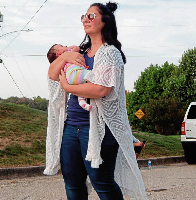 Deanna Manley of Greensburg holds infant daughter, Kennedy , during a neighborhood block party of residents of Birnham Drive in Greensburg on Friday<ins>,</ins><ins> Sept. 25, </ins><ins>2020</ins>. Deanna and her husband, Derek , had a nice evening for an outing that attracted about 40 people in the close-knit neighborhood in the northern end of the city.