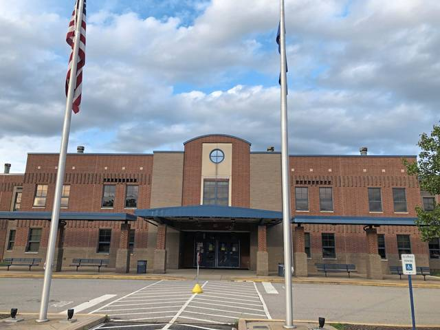 Norwin reopened five of its schools including the high school (above) on Tuesday after being closed last week because of an outbreak of the virus.