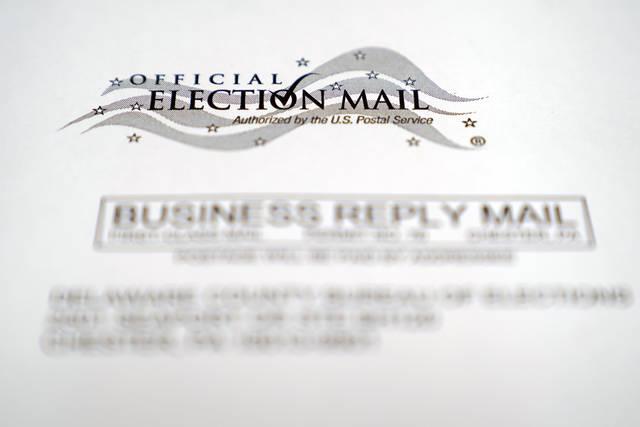 An envelop holding a Pennsylvania mail-in ballot