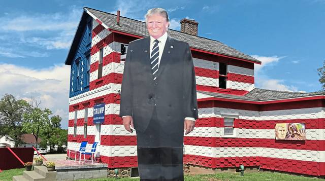"A giant image of President Donald Trump greets visitors to the ""Trump House"" near Latrobe."