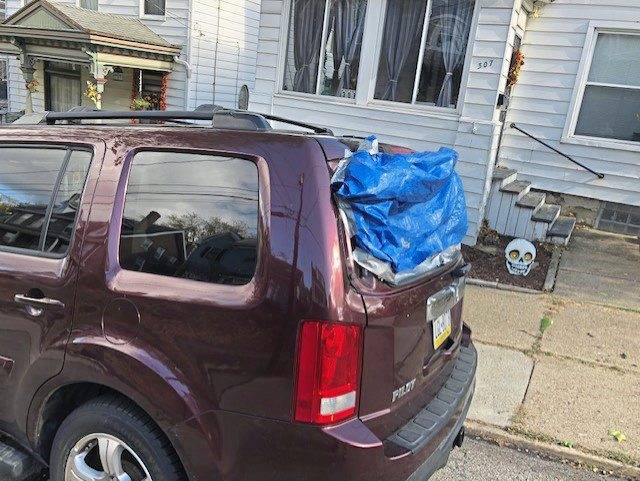 Police are investigating who shot out vehicle windows in Greensburg, including the rear window of this SUV on Walnut Street, late Halloween night or early Sunday.