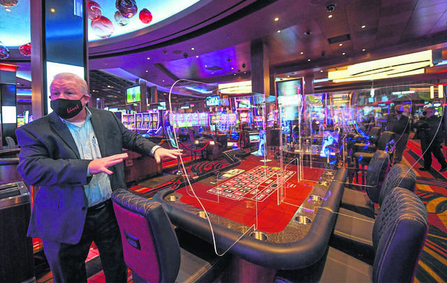 Sean Sullivan, vice president and general manager of Live! Casino Pittsburgh at Westmoreland Mall, shows the Plexiglas screens at the game tables for patrons safety.