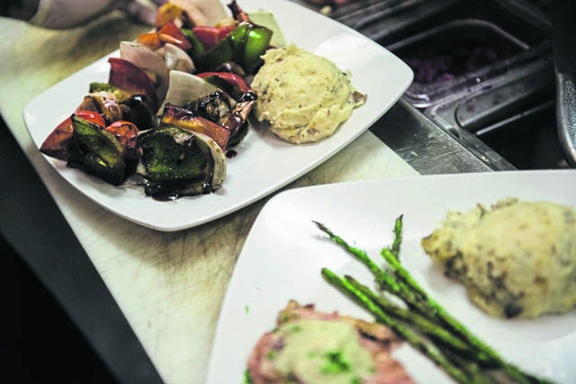 Greensburg Restaurant Week is set for Jan. 25-31. Shown are Tapped Brick Oven and Pour House's shrimp kabob and stuffed chicken entrees from the January 2020 event.