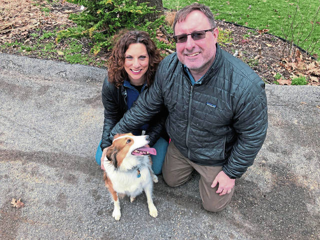 Eloise and Ray Milligan of Murrysville pose for a photo with their dog Bullet, a Shetland sheepdog, on Friday, March 26, 2021.
