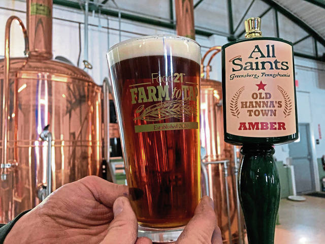 """All Saints Brewing's latest offering, Old Hanna's Town Ale, is brewed with grains grown right up the road at a neighboring farm, part of Food21's """"Farm to Tap"""" initiative."""