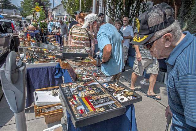 Shoppers browse for treasures during a 2014 session of Antiques on the Diamond on Main Street in Ligonier.