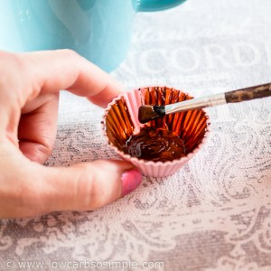 Frozen Peanut Butter Cups; Brushing the Silicone Mini Muffin Cup with Melted Chocolate | Low-Carb, So Simple