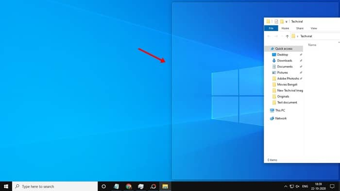 pull the Window to either right or left border of your screen
