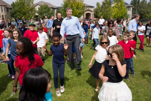 """Education Secretary Arne Duncan dances the """"Cupid Shuffle"""" with students at Lowry Elementary School in Denver, Colo. Source: whitehouse.gov"""
