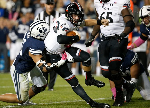 Oct 16, 2015; Provo, UT, USA; Cincinnati Bearcats quarterback Hayden Moore (8) is tackled by Brigham Young Cougars linebacker Harvey Langi (21) in the fourth quarter at Lavell Edwards Stadium. Mandatory Credit: Jeff Swinger-USA TODAY Sports