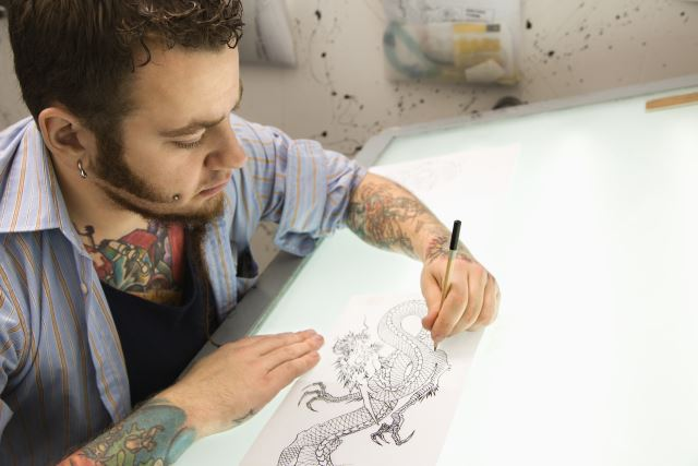 Tattoo Artist Designing a Tattoo