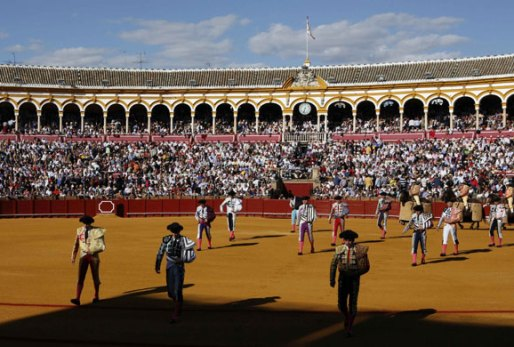 Toreros performing the paseillo parade to trumpets playing the Paso Doble.