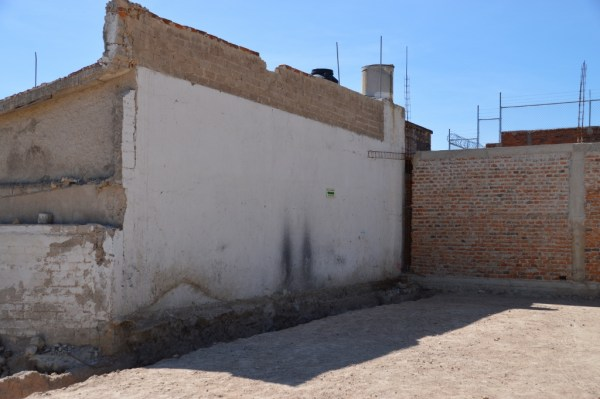 The only remaining wall from the original building. It still has an evacuation route notice.