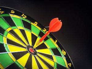 dart board with bull's eye dart in center