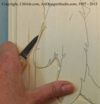 Two stroke stop cut in relief wood carving
