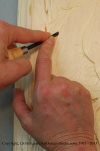 Using a v-gouge in relief wood carving