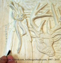 Shaping feathers in wood carving