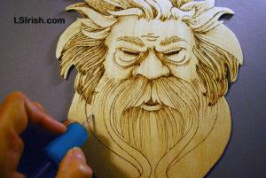 wood burning the wood spirit face