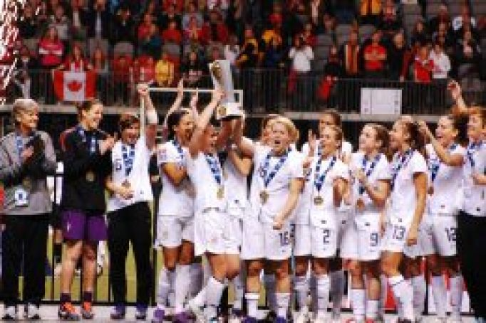 The USWNT Celebrates their first place victory as Captain Christie Rampone raises the trophy at the 2012 CONCACAF Olympic Qualifiers.