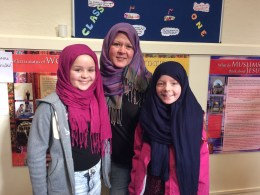 Lucy, Vicky and Katelyn Henderson trying out the hijabs at the mosque open day in Lincoln.