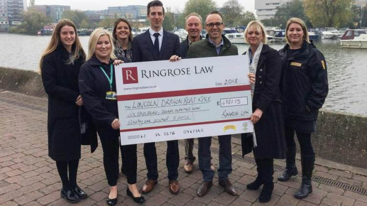 Cheque presented to representatives of the three charities - Credit: Ringrose Law