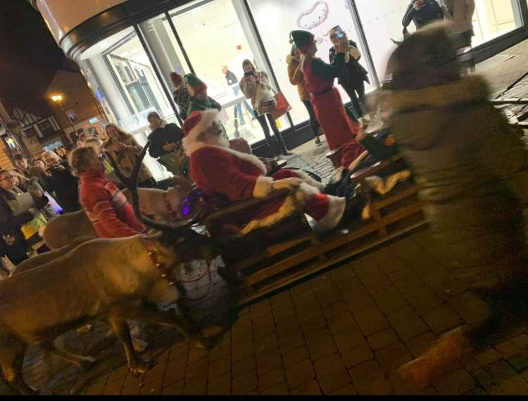 Santa rides past with the reindeers. Photo credit: Bethany Lee