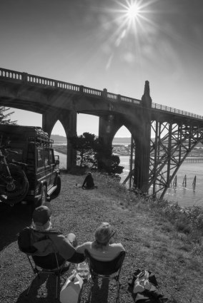 Eclipse chasers sitting by Yaquina Bay Bridge, Oregon, USA. Photo: Keith James