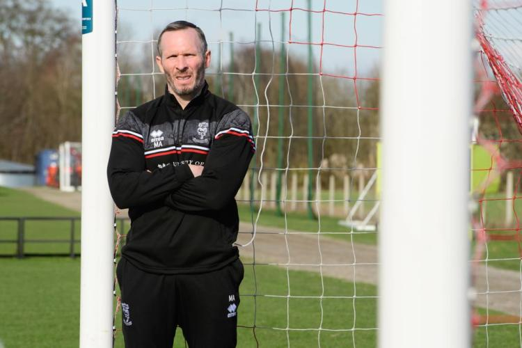 Michael Appleton after signing a new contract with the Imps. Credit: Lincoln City