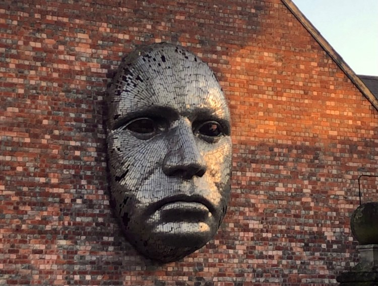Sculpted in metal, 'The Face' by Rick Kirkby distinguishes the Lincoln Drill Hall, viewed from Free School Lane. It was installed in 2007. Photo by Brooke Becher