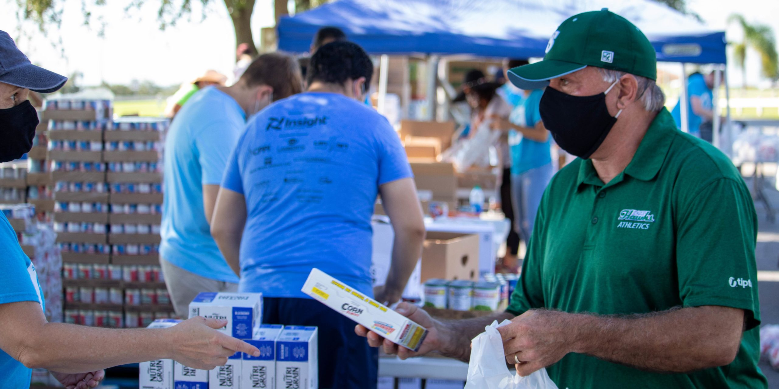 Dr. Sidor packages food at the food distribution event in Clermont
