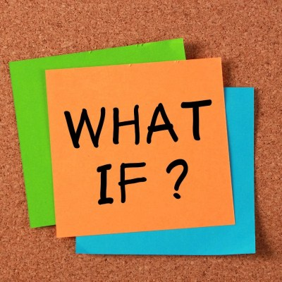 """Image of a yellow post-it note stating: """"What If""""? on a brown peg board, representing the uncertainty Paulina felt about her future."""