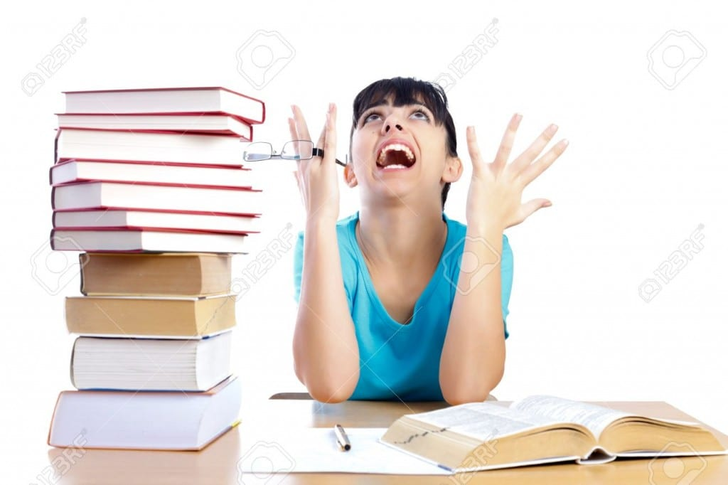 19176190-angry-student-screaming-stressfully-and-holding-glasses-while-studying-isolated-on-white-part-of-a-s-stock-photo