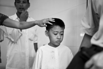 This young boy is awaiting his open heart surgery paid by East Meets West. Ho Chi Minh City. Vietnam. 2007