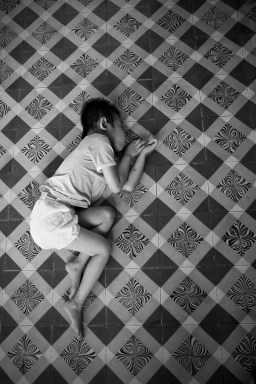 A young boy sleeps on the floor of the GoVap Orphanage. Ho Chi Minh City. Vietnam. 2007
