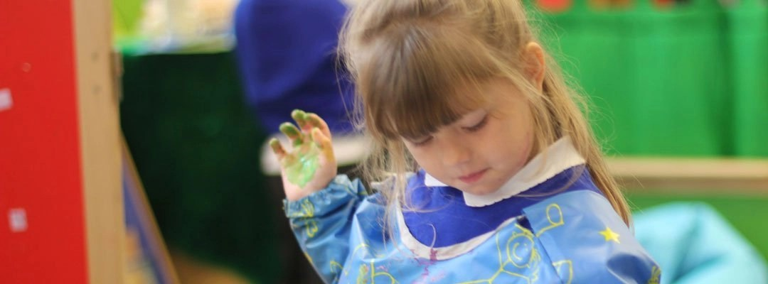 Young girl painting at the After School Club
