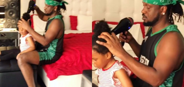 """""""We deal on anything hair"""" - Rudeboy says as he makes daughter's hair (Video)"""
