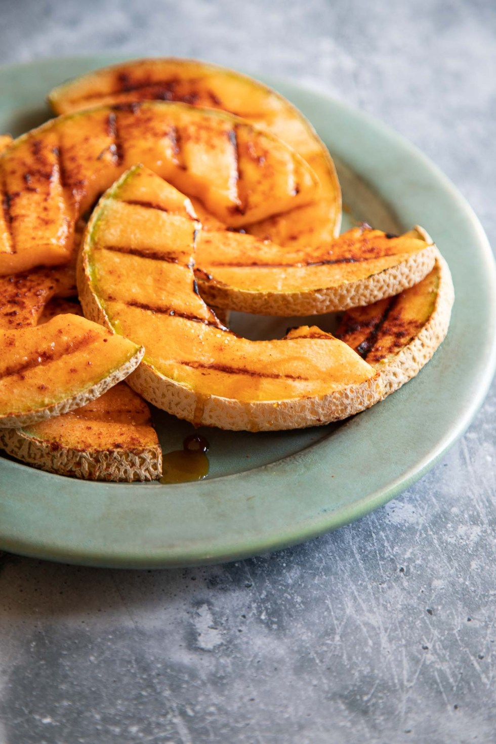 Grilled Cantaloupe on Pale Turquoise Plate