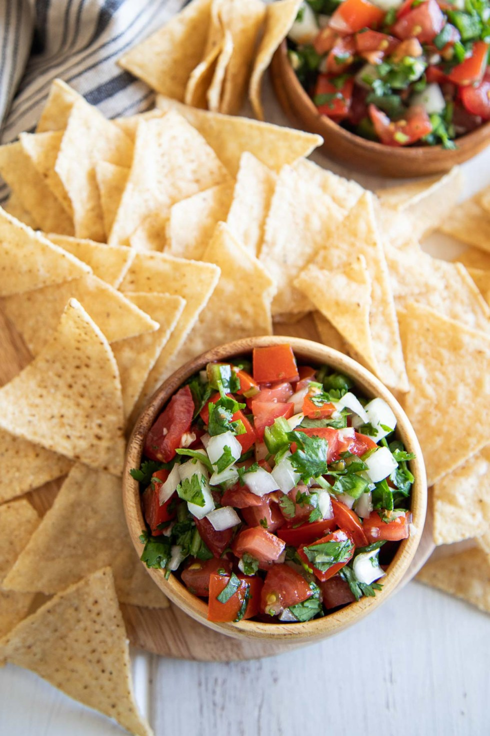 Looking down at Homemade Pico de Gallo Salsa and Chips. Appetizer.
