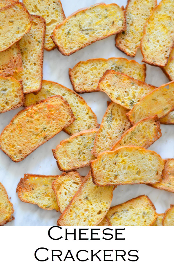 Homemade Cheddar + Herb Cheese Crackers Recipe. Delicious homemade crackers with fresh rosemary - a great snack or appetizer.