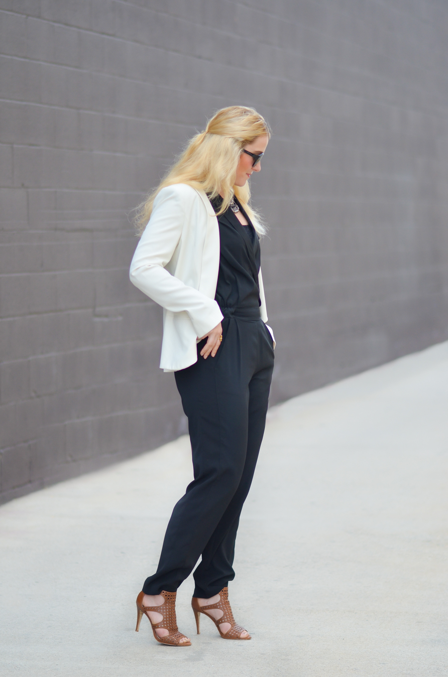 How to Style Black Jumpsuit + White Blazer What to Wear Over a Sleeveless Jumpsuit
