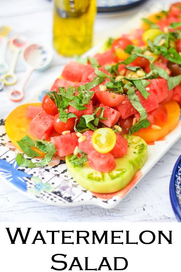 Watermelon Salad. A perfect summer salad with heirloom tomatoes and watermelon. A delicious salad to serve guests on a warm evening. Great salad for potlucks and bbqs.