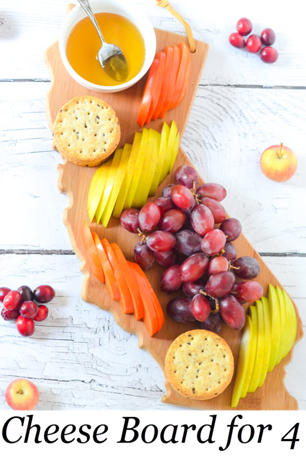 Cheese Board for 4 People. 10 Minute Fast Cheese Board. Fresh Fruit Appetizer Board for 4 People. An easy starter for entertaining guests. This board is great to put out for guests when they arrive before food is ready! #entertaining #appetizer #vegan #dinnerparty #appetizer #foodblog