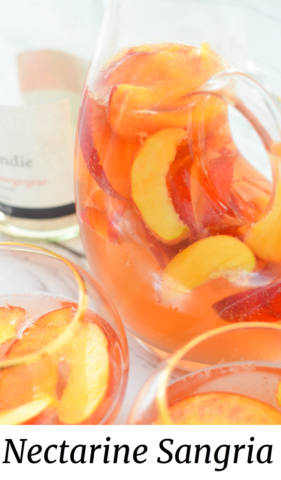 Nectarine Sangria w. Ginger + Orange Liqueur. A fresh fruit summer sangria. This nectarine cocktail made with sparkling rose wine is a great summer drink. #lmrecipes #sangria #cocktail #cocktails #drinkrecipe #summer #nectarines #summerrecipes #foodblog #foodblogger