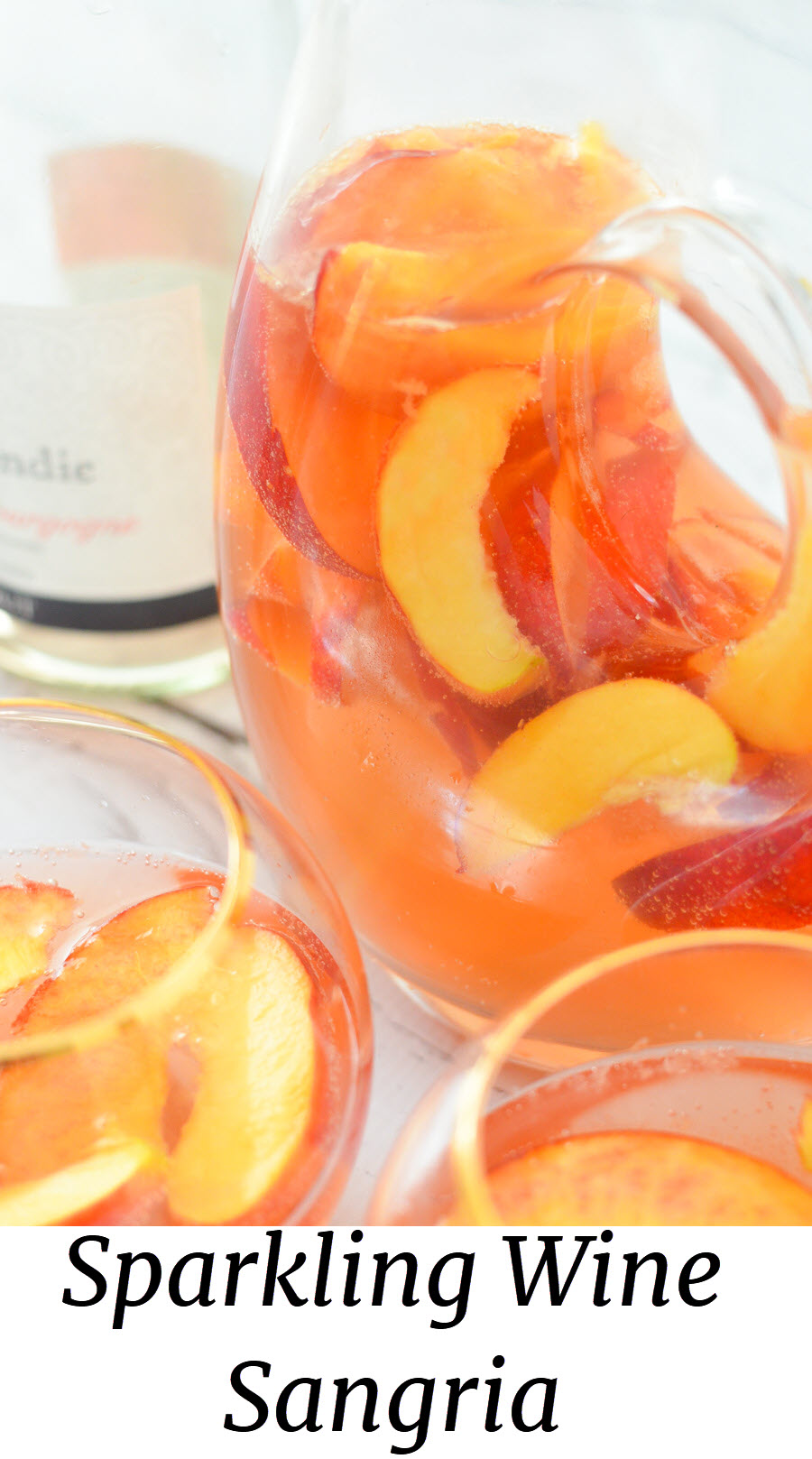 Sparkling Wine Sangria. Nectarine Sangria w. Ginger + Orange Liqueur. A fresh fruit summer sangria. This nectarine cocktail made with sparkling rose wine is a great summer drink. #lmrecipes #sangria #cocktail #cocktails #drinkrecipe #summer #nectarines #summerrecipes #foodblog #foodblogger